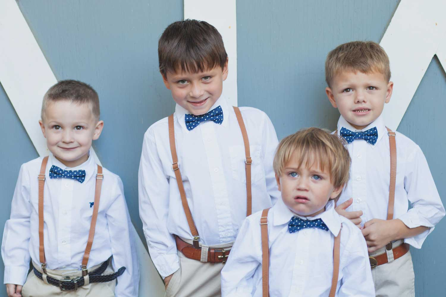 junior groomsmen in suspenders and blue bowties for Swor Cottage wedding