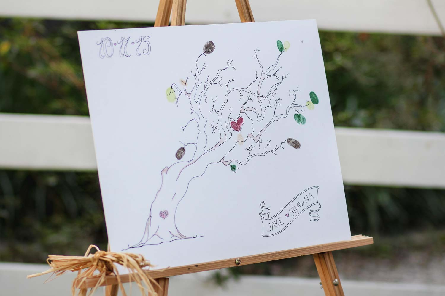 canvas with tree on easel for wedding guest book