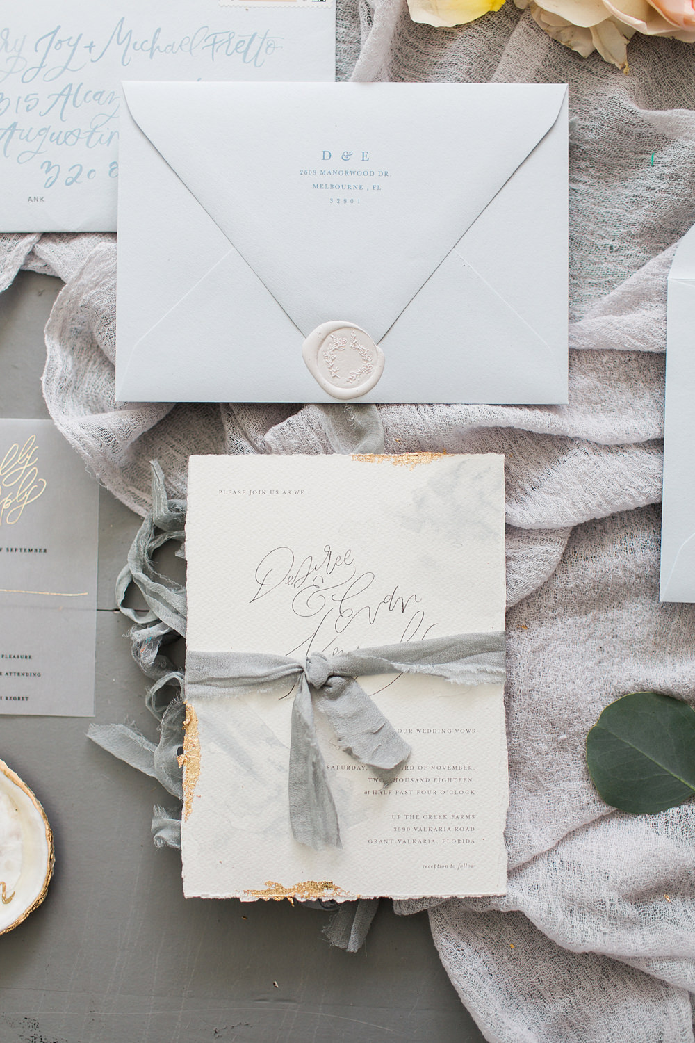 White and grey wedding invitation suite-flatlay style.