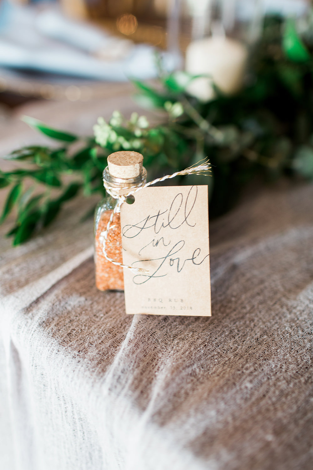 """Wedding favor with a """"still in love"""" sign."""