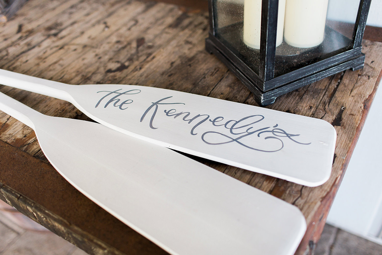 Personalized boat oars as a unique guest book idea.