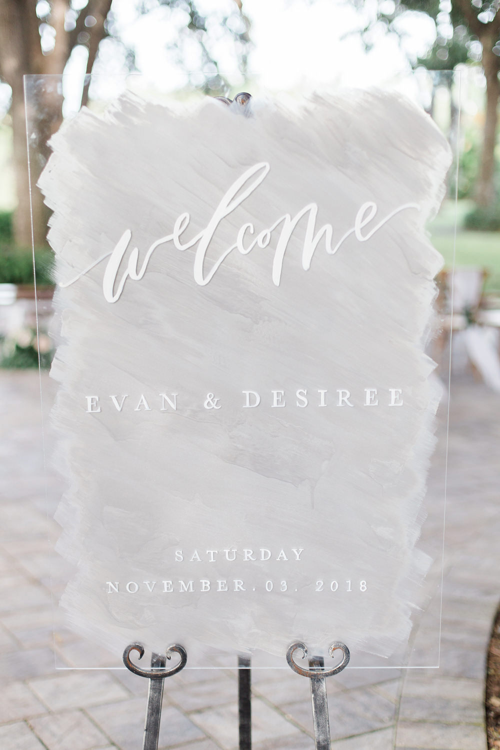 Acrylic welcome sign with white and grey.