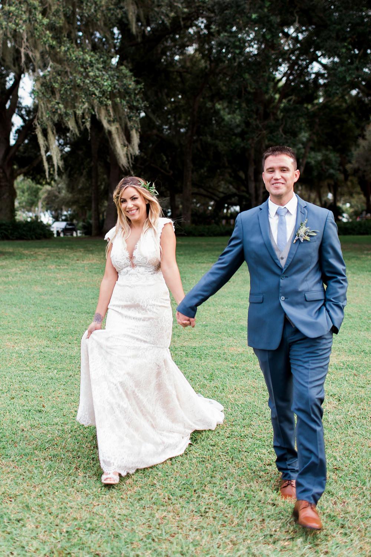 Bride and groom walking towards the camera.