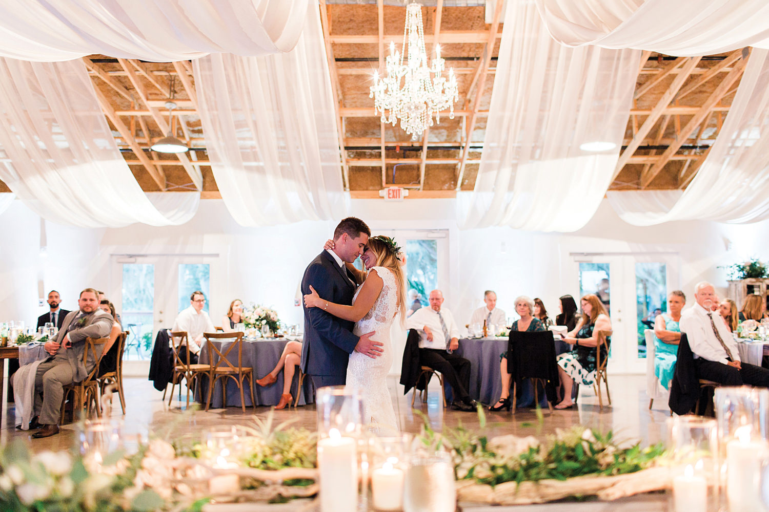 Bride and grooms first dance in a barn wedding venue.