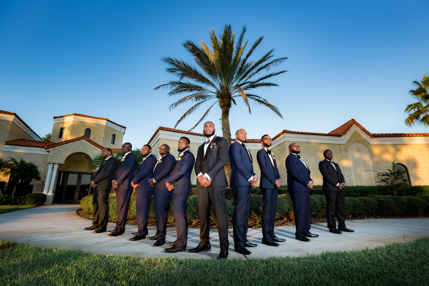 Groomsmen posed outside of their wedding venue.
