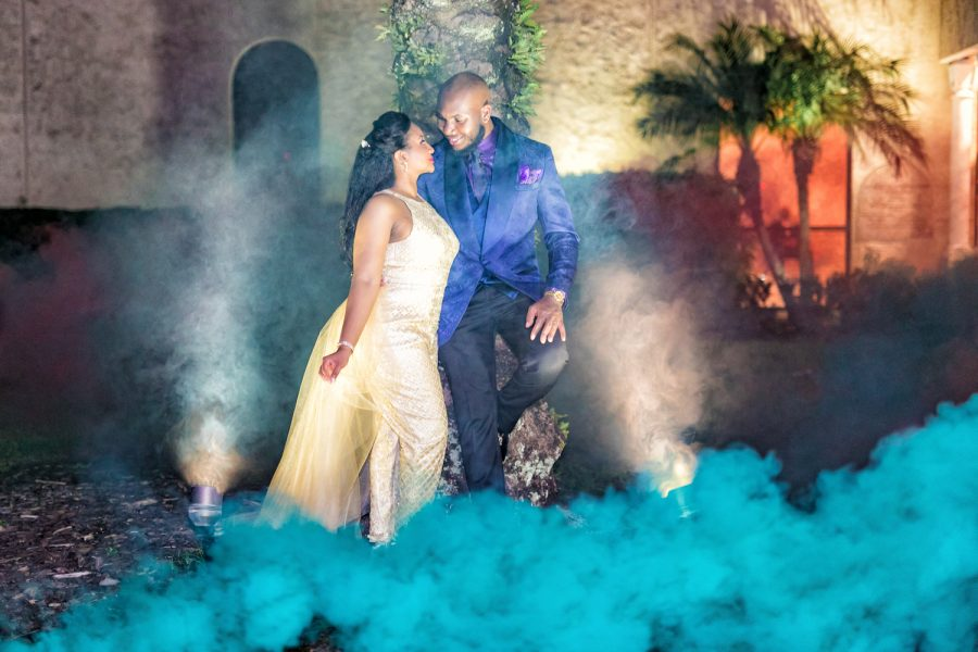 Smoke bomb picture of a bride and groom on their wedding day.