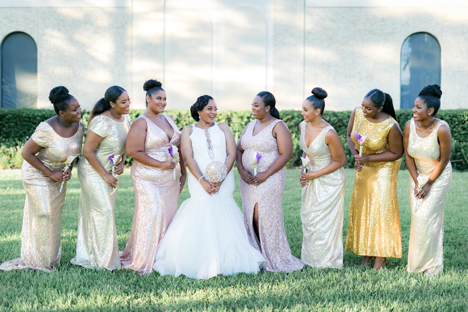 Bridesmaids with the bride. They are dressed in a pastel color palette.
