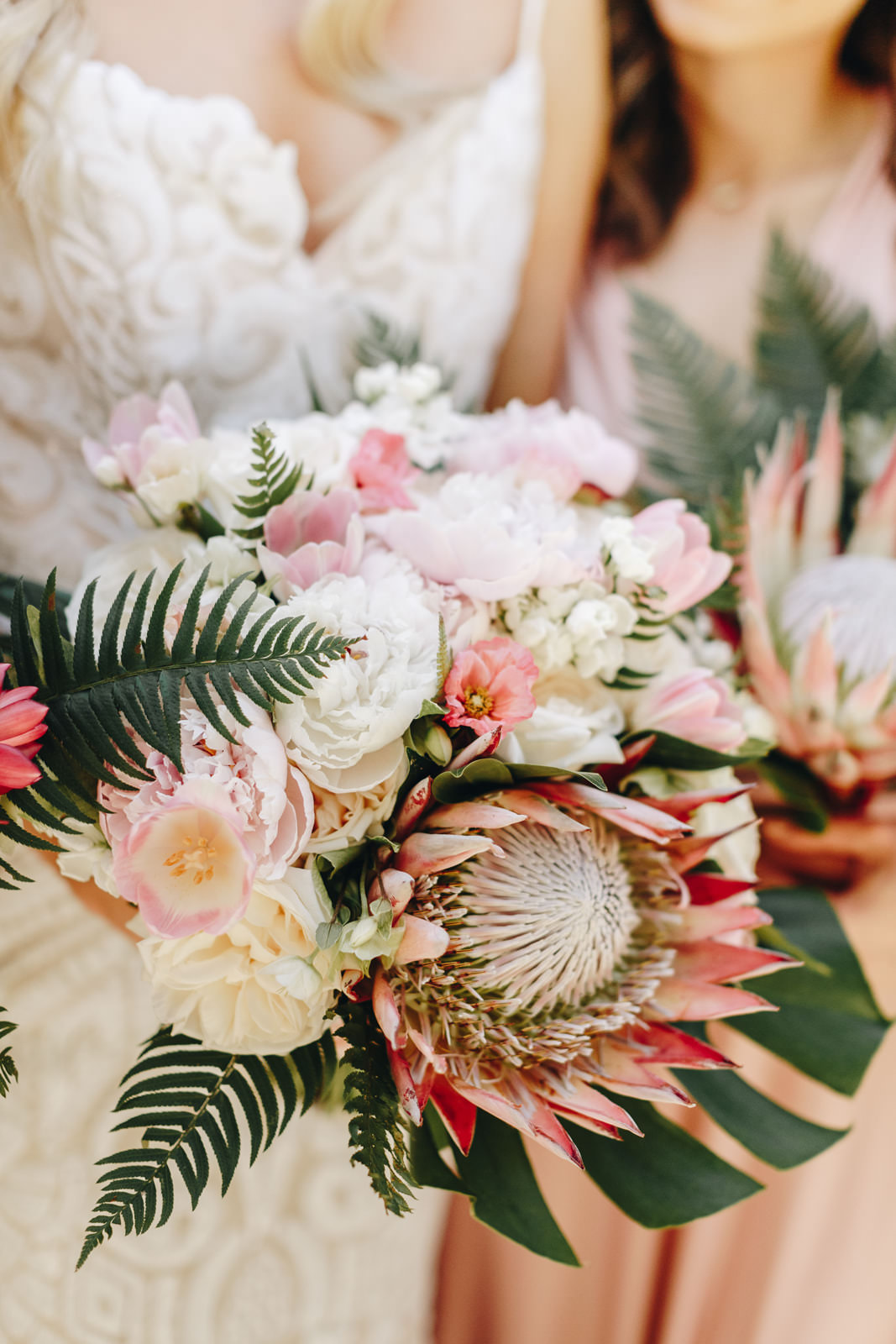 Pink, blush, and greenery wedding bouquet with greenery fern accents.