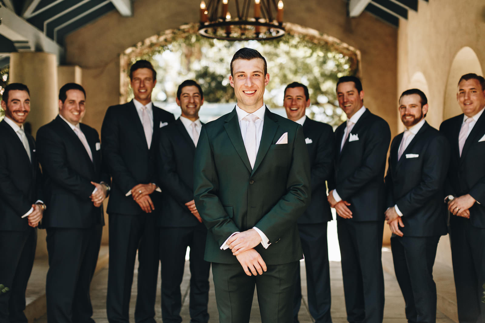 Close up of the groom with his groomsmen standing behind him.