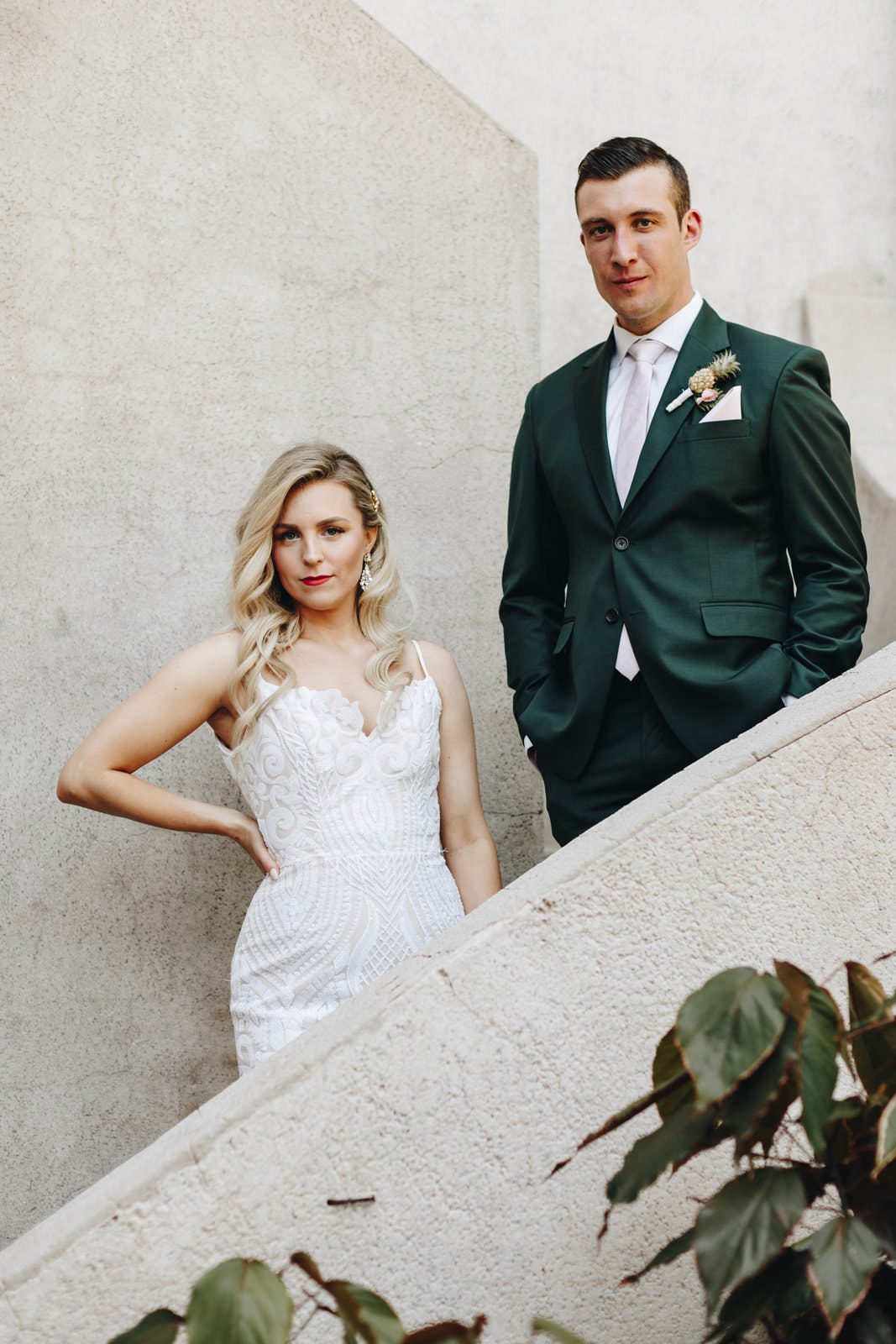 Wedding picture of bride and groom taken on the stairs.