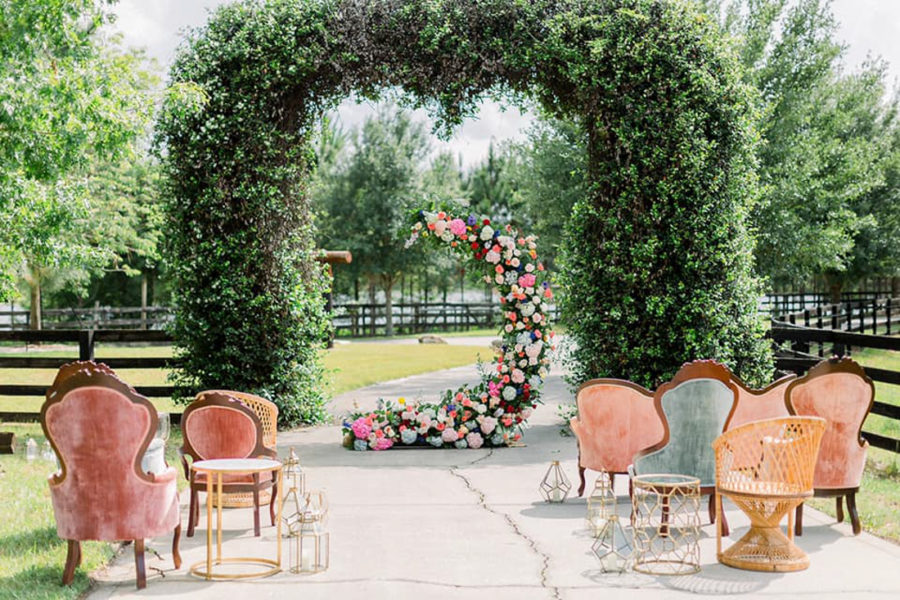 Unique flower installation used as a ceremony arch backdrop