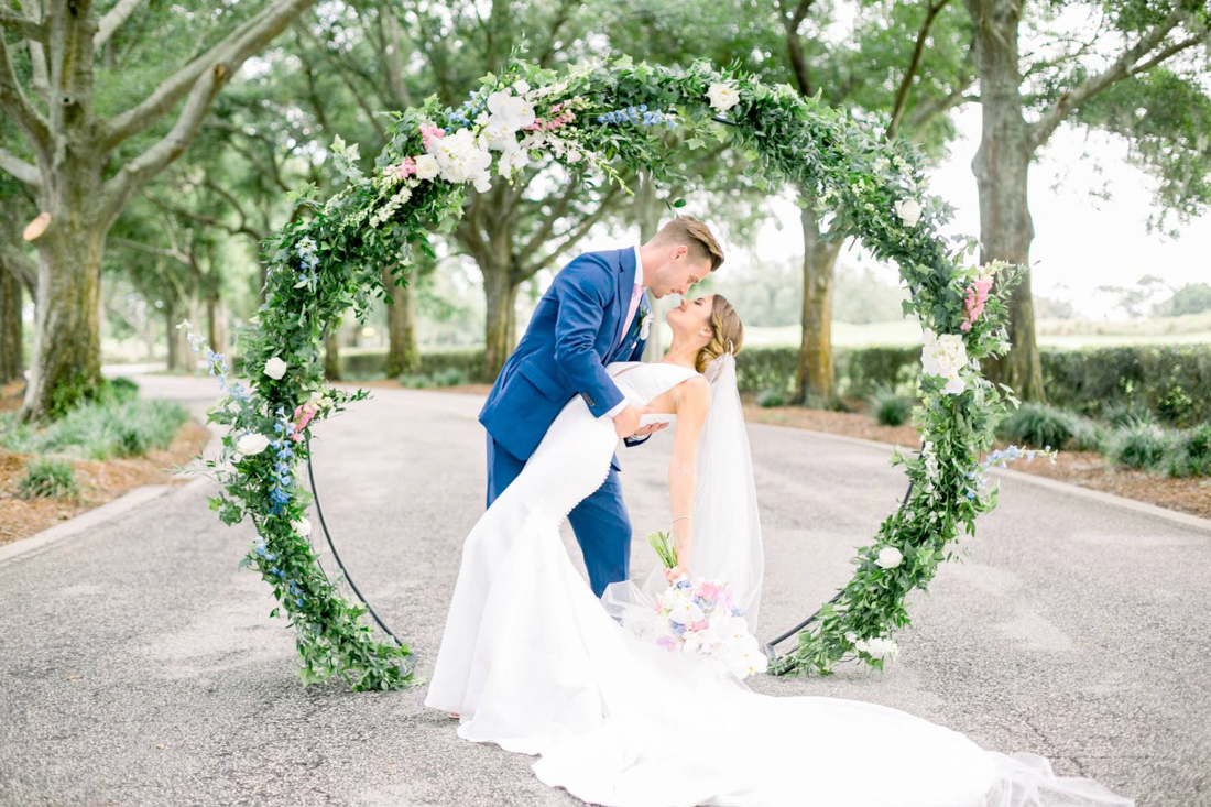 Infinity wedding arch with greenery and flowers all around