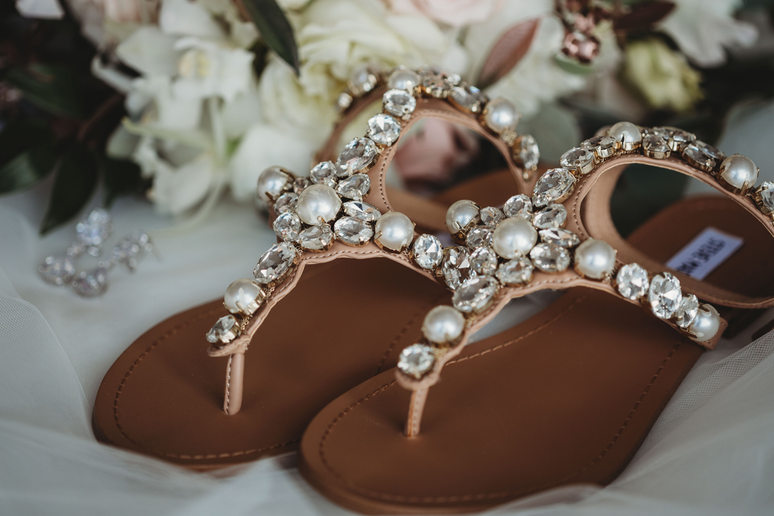 Bride's wedding sandals with rhinestones and pearls.