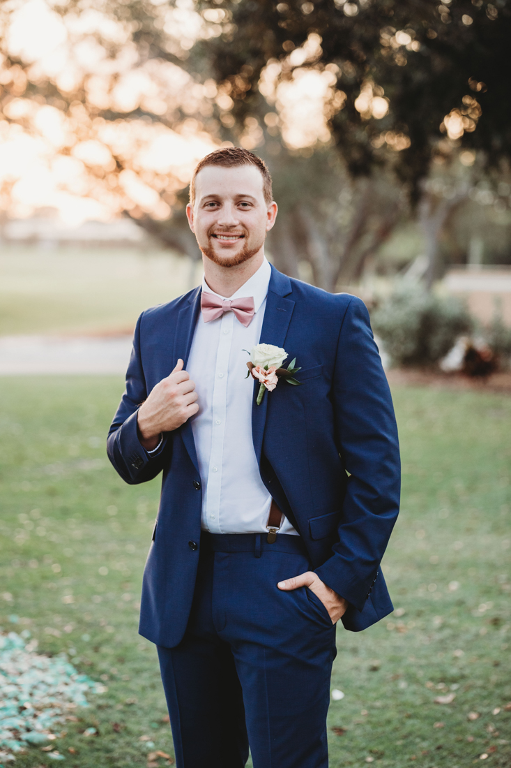 Groom holding his suit jacket