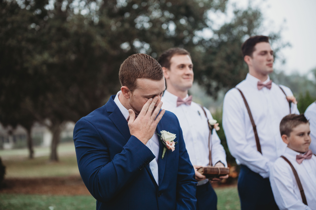 Groom crying when his bride walks down the aisle