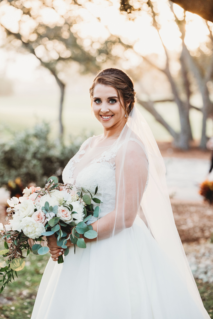 Portrait of a bride holding her wedding bouquet