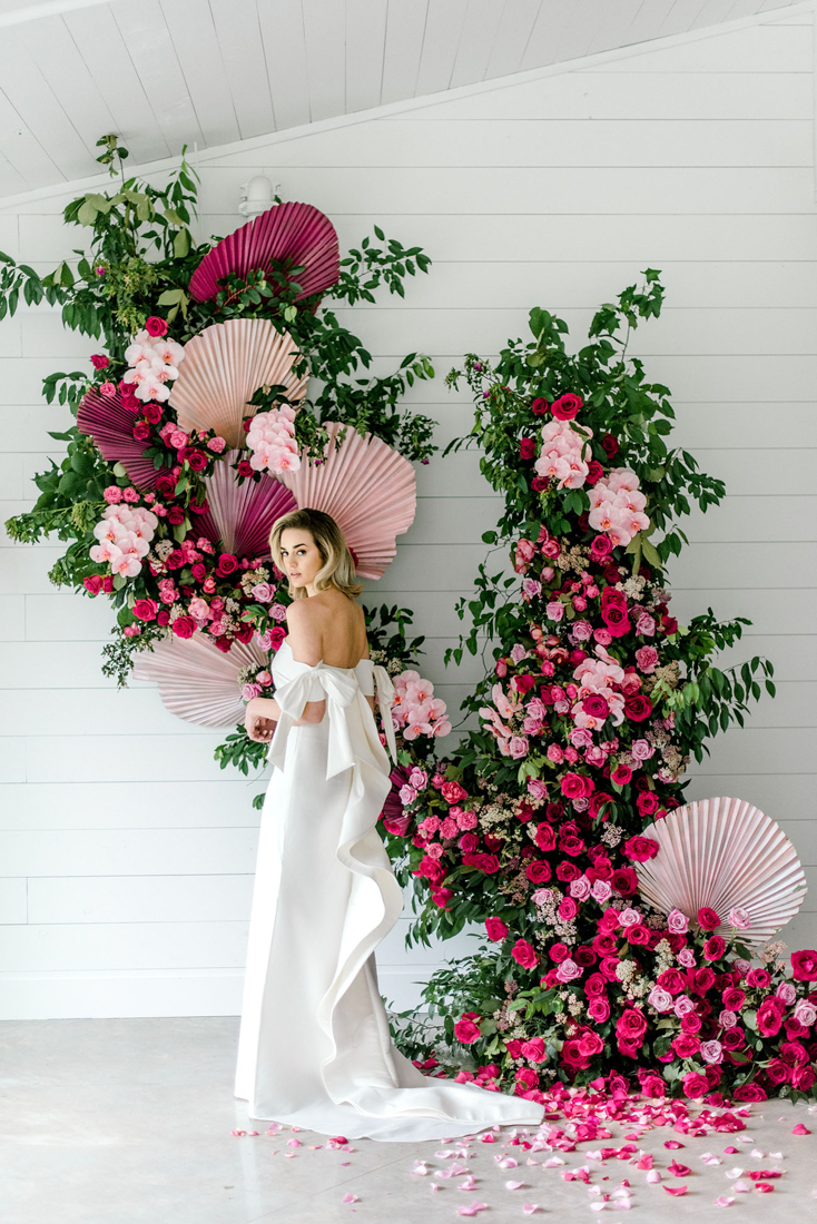 Pink flower installation used as a ceremony backdrop
