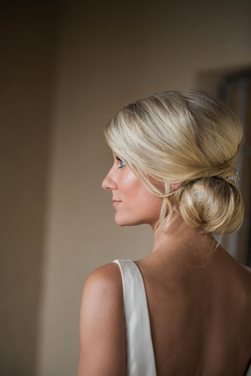bride with side bun updo for wedding