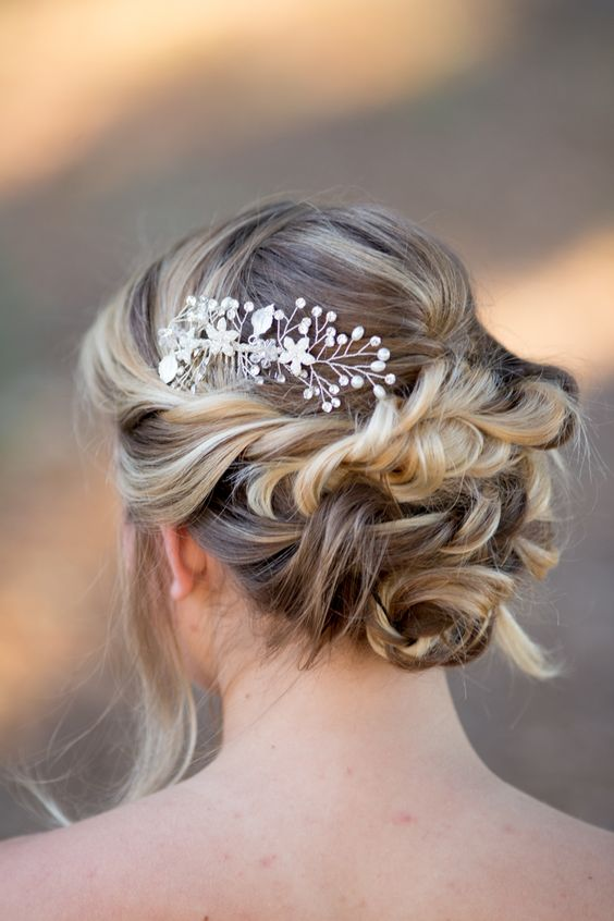 bridal updo hairstyles with rhinestone hair comb