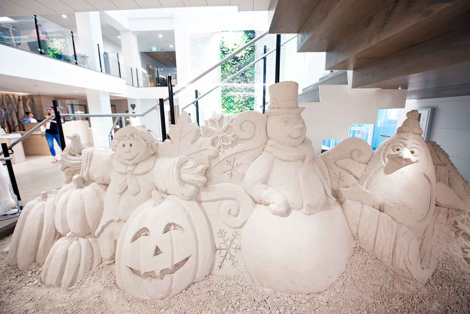 holiday sand sculptures under staircase