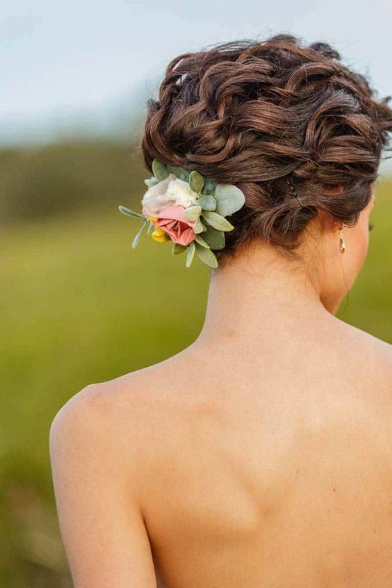 curl hair in bridal updo with RaggaWedding floral hair clip