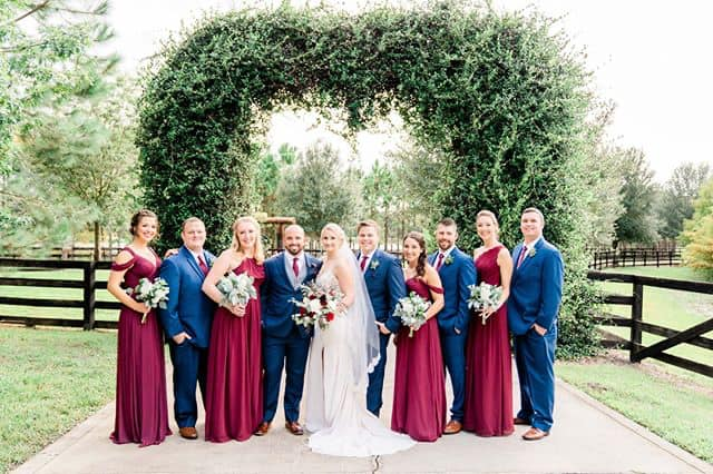 Groomsmen and Bridesmaids posing with bride and groom