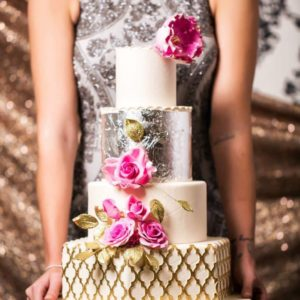 4 tiered gold, cream, and silver wedding cake