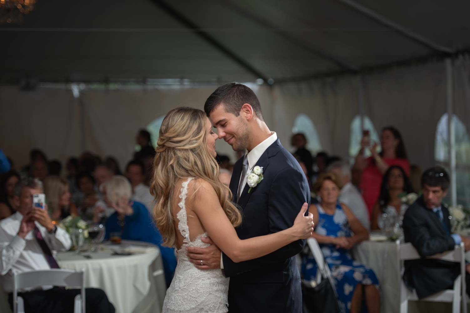 bride and groom smiling during their first dance