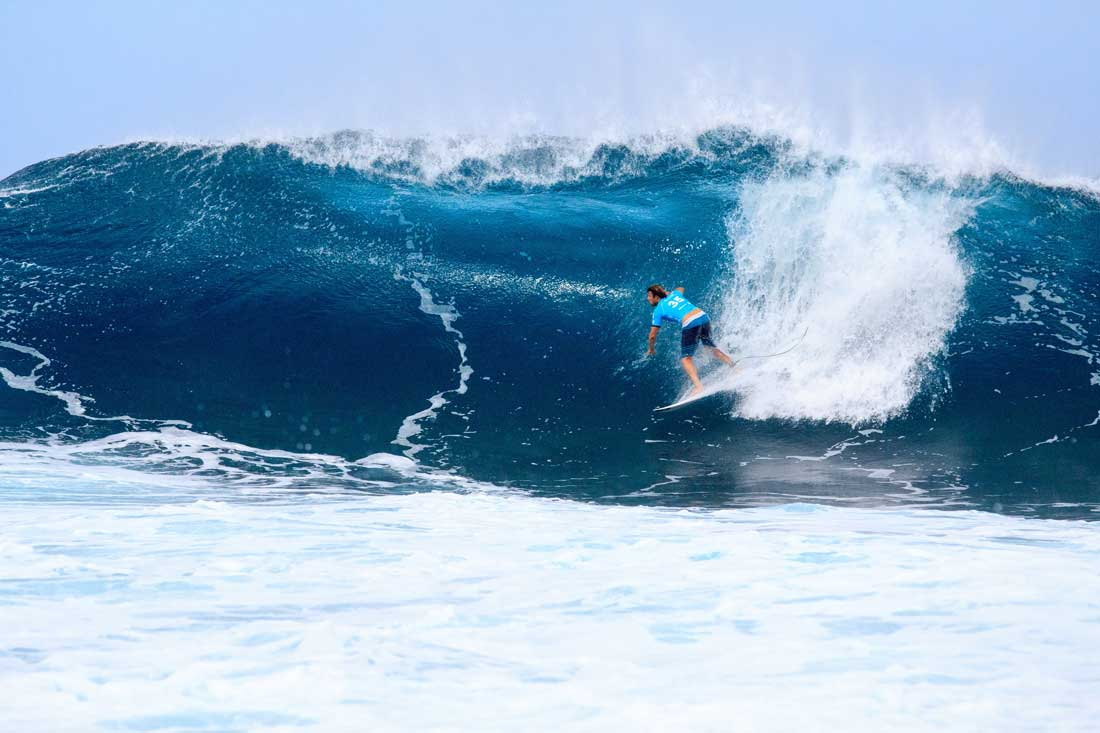 Surfer riding a wave at Pipeline