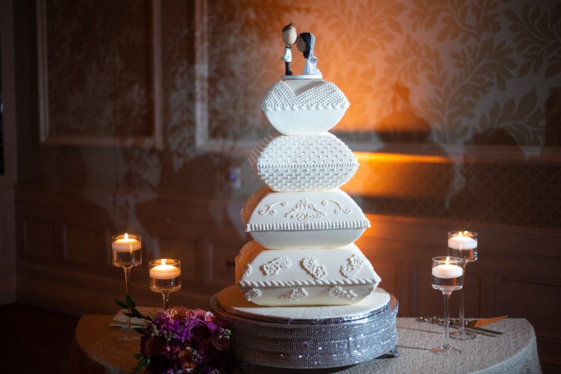4 tiered white pillow cake with details