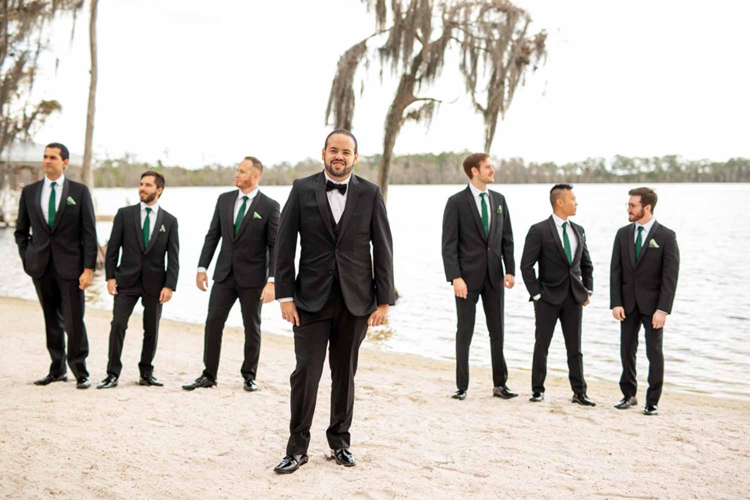 groom with groomsmen on beach a Paradise Cove