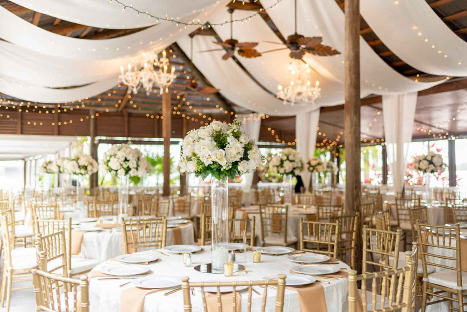 outdoor wedding pavilion at Paradise Cove with tall white floral centerpieces