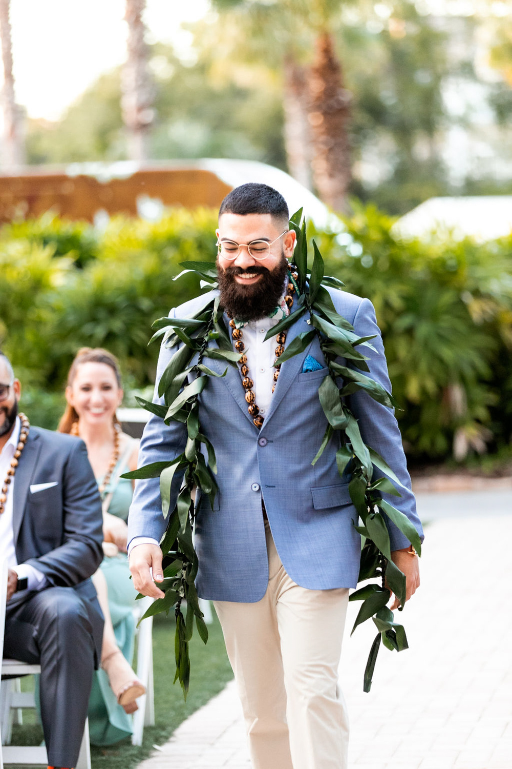 groom waling up aisle for wedding ceremony at Paradise Cove