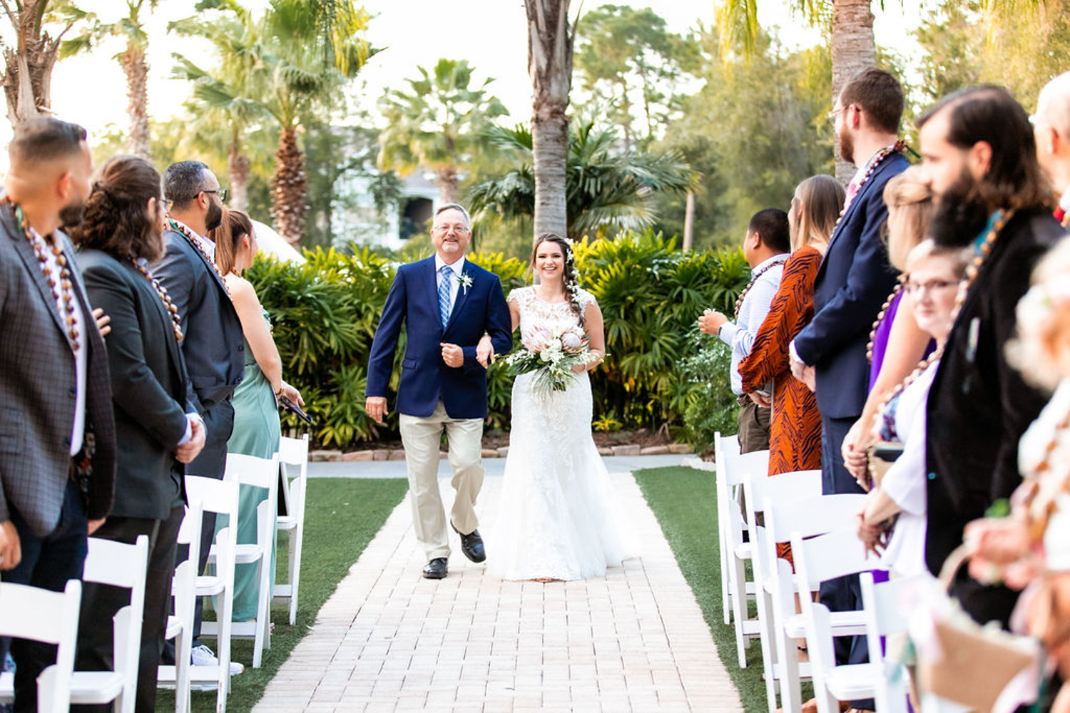 bride walking up aisle with father for wedding