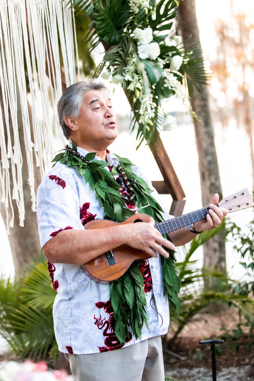 Hawaiian ukulele player singing at wedding ceremony