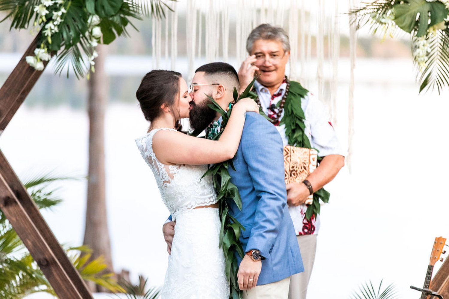 bride and grooms first kiss for wedding at Paradise Cove