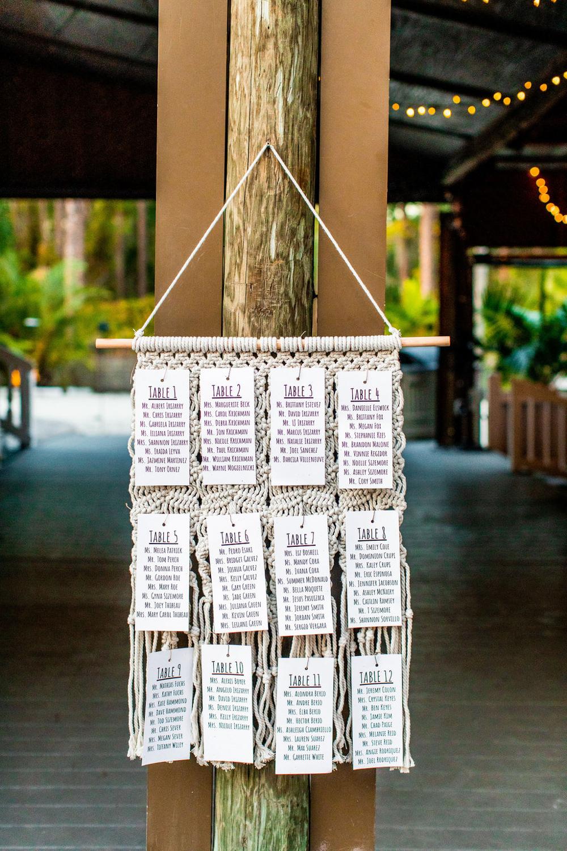 wedding seating chart on hanging macrame