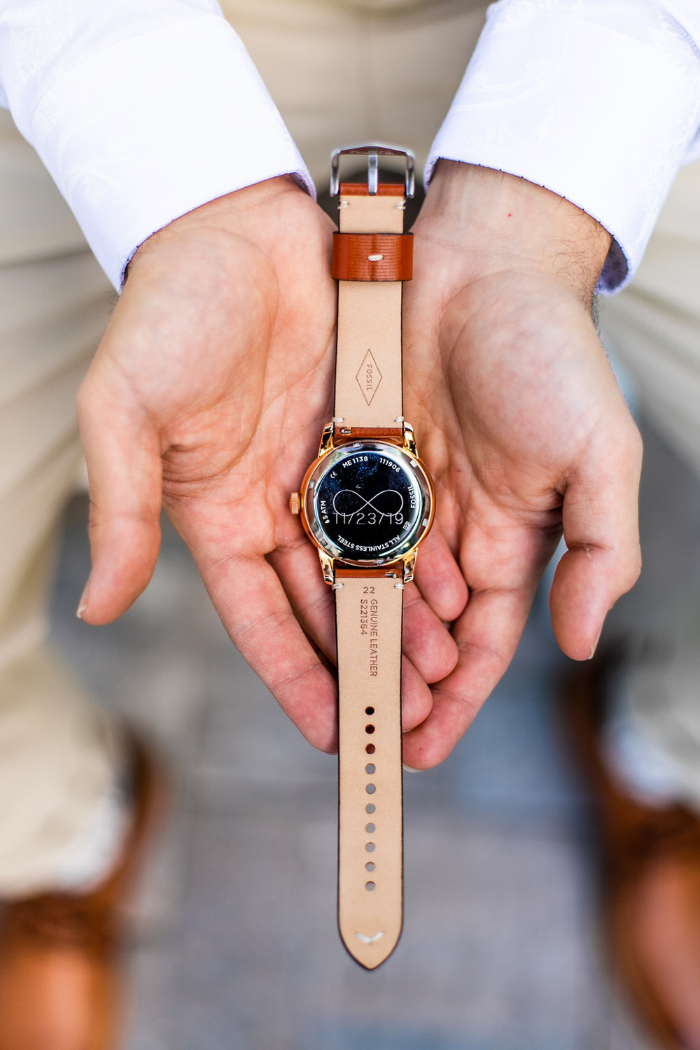groom watch with wedding date and infinity symbol on the back