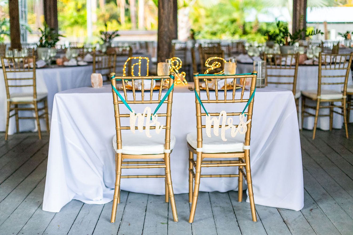gold chiavari chairs with mr and mrs signs for Paradise Cove wedding reception