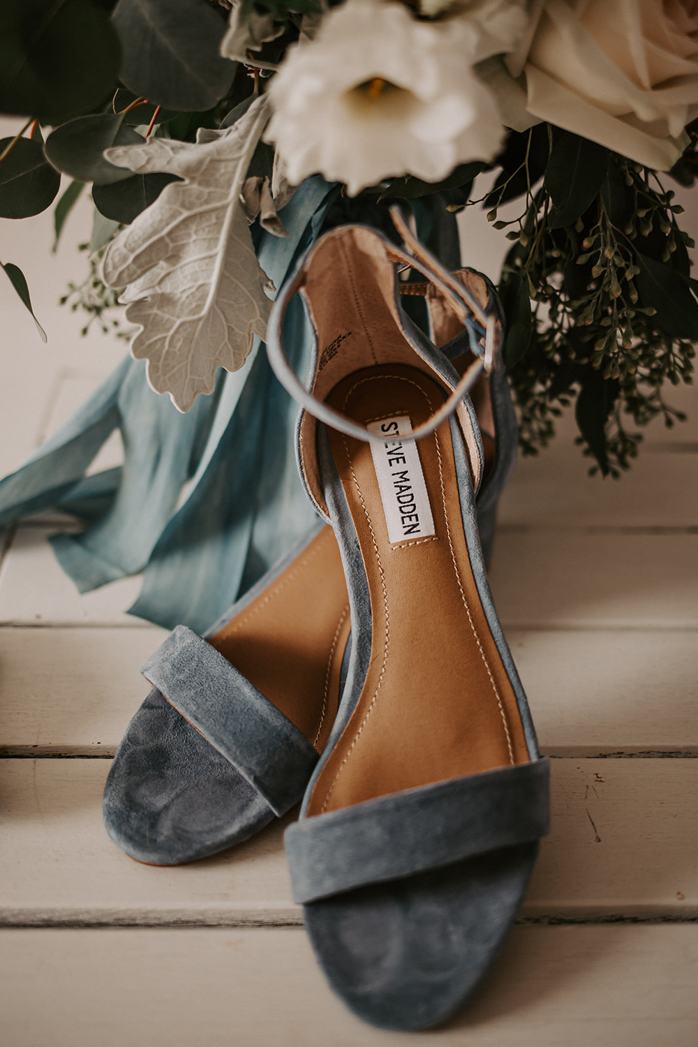 slate blue chunky heel wedding shoes on white table