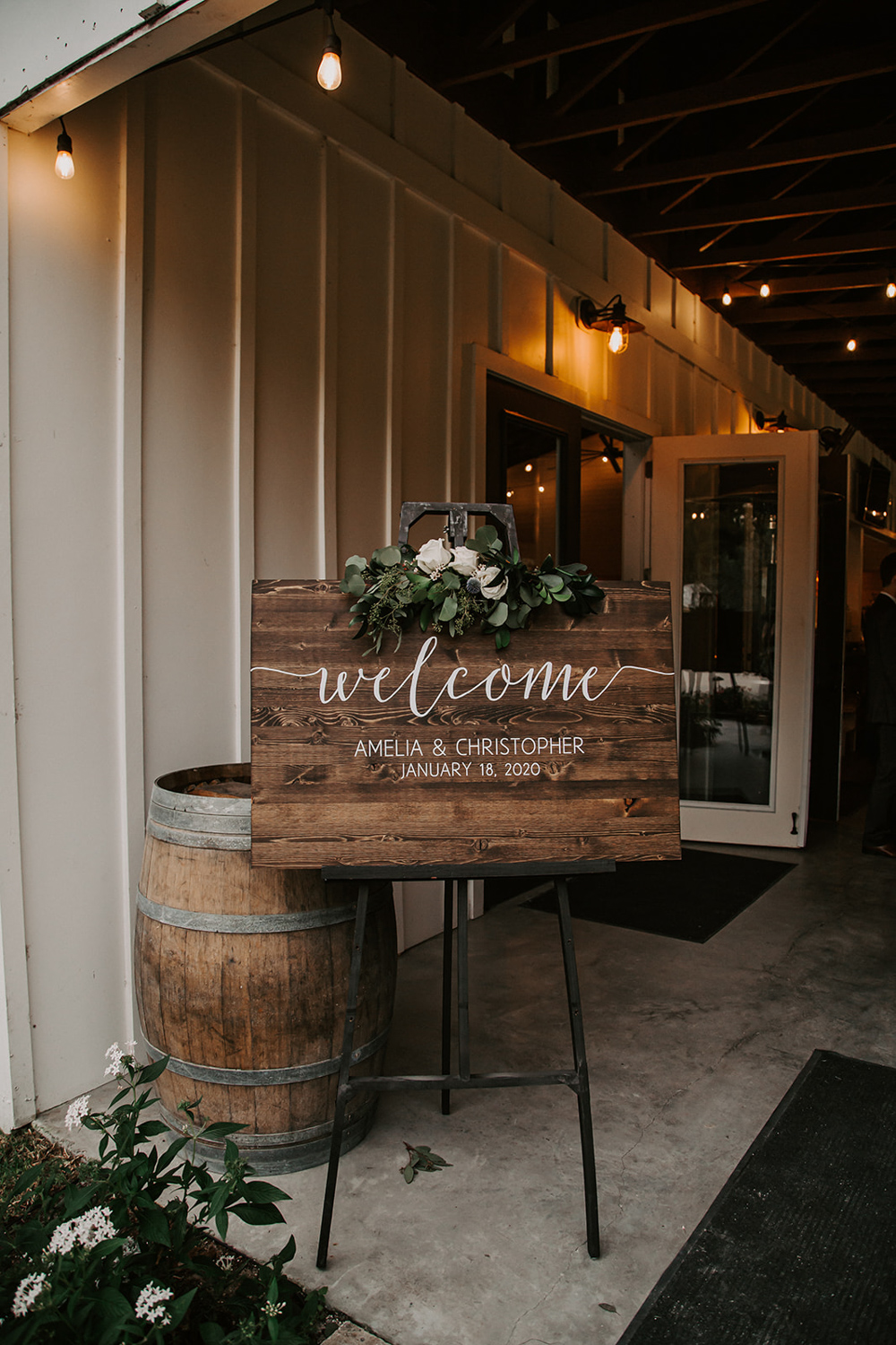 rustic wedding welcome sign on black easel