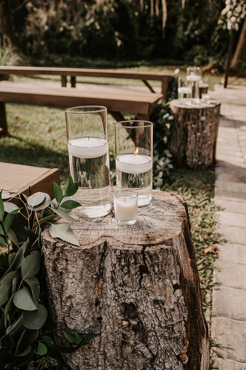 floating candles on cut log for wedding ceremony