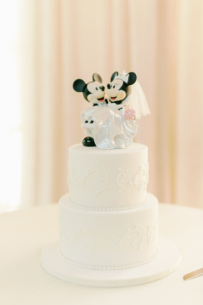 White buttercream wedding cake with Minnie and Mickey cake topper