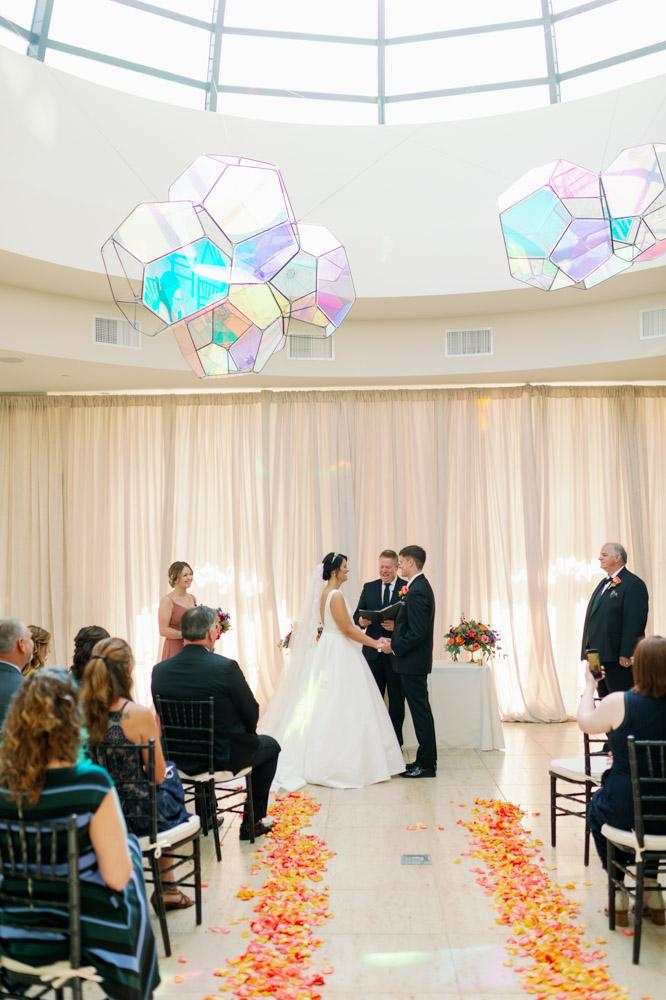 bride and groom saying wedding vows for indoor wedding ceremony