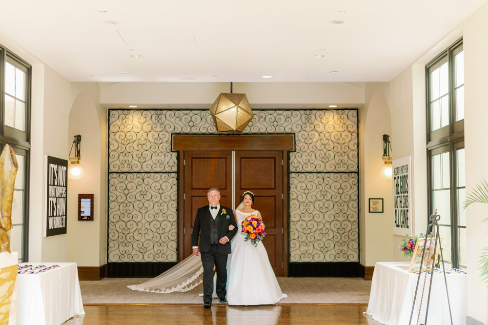 father and bride walking up aisle for wedding ceremony at The Alfond Inn