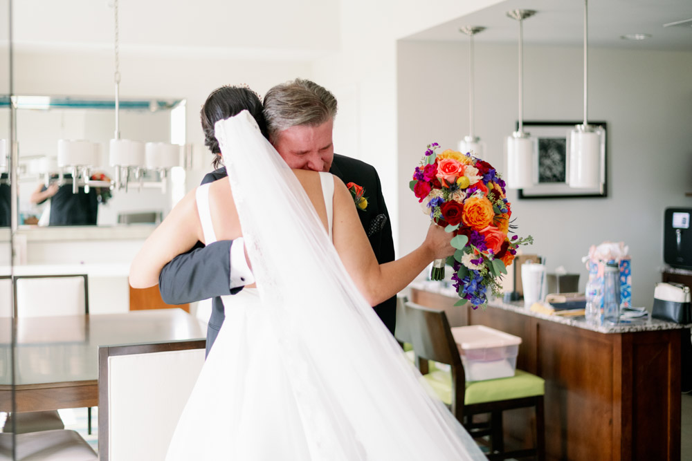 father and daughter hugging on wedding day for first look