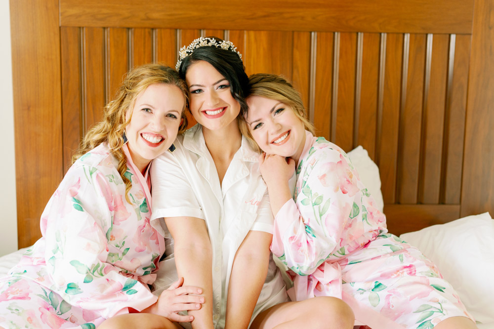 bride and bridesmaid getting ready at The Alfond Inn