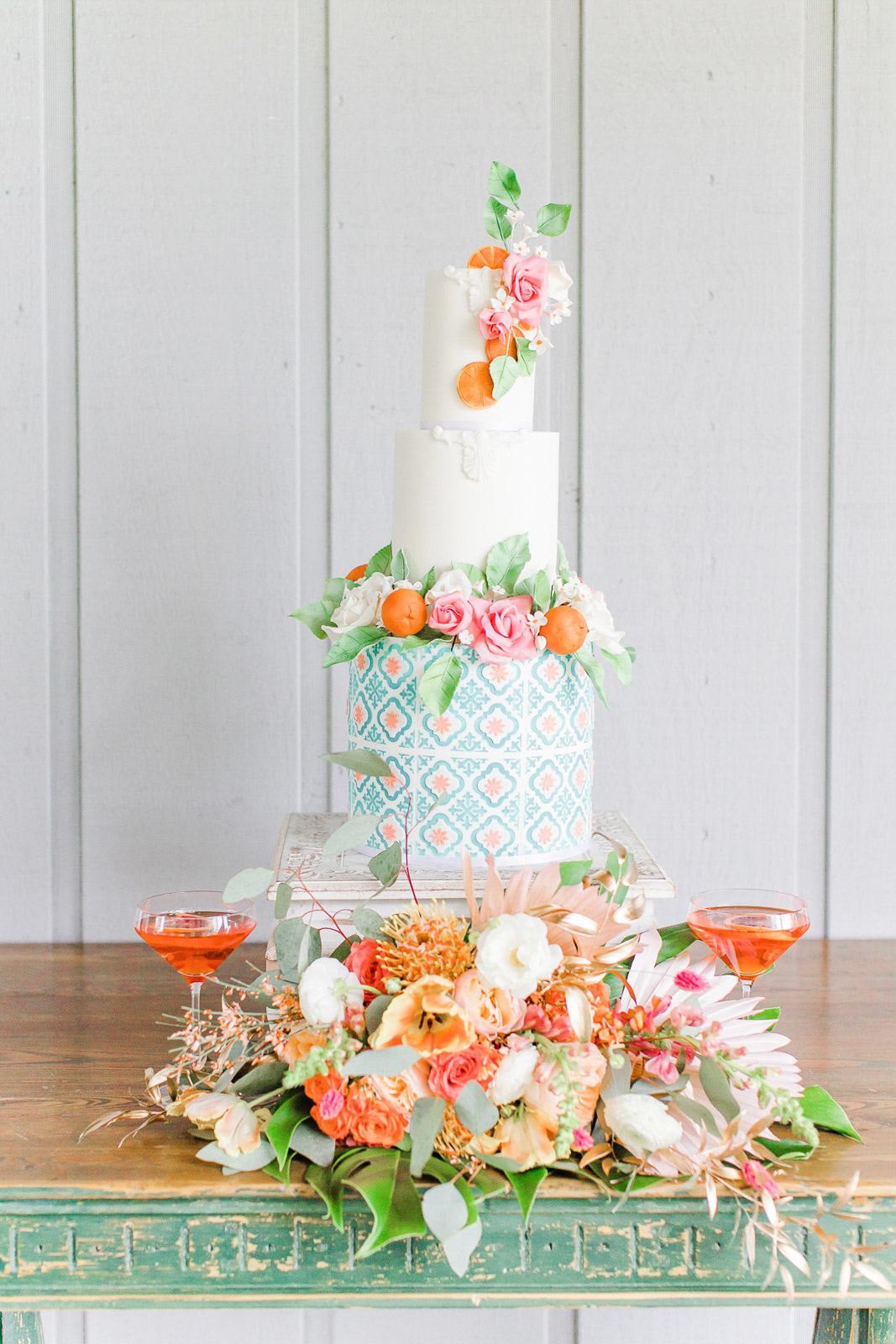 Old Florida inspired wedding cake with citrus and tile details