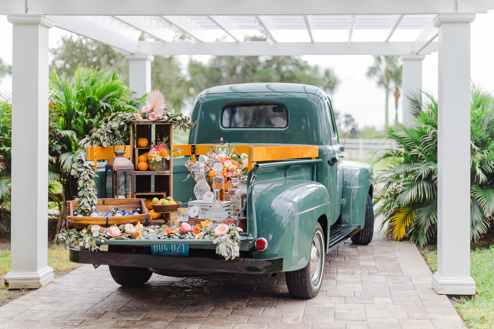 Teal vintage ford truck with a wedding bar on truck bed