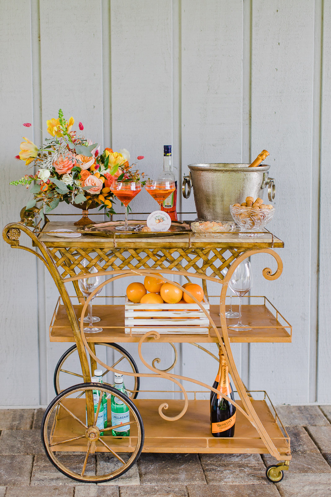Wedding bar cart with citrus inspired drinks and florals